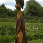 Owl and Otter Chainsaw Carving