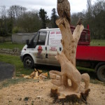 chainsaw carved owl and fox stump